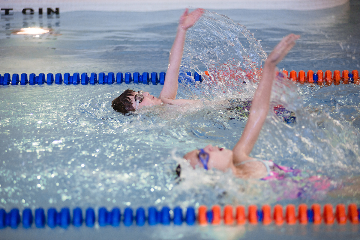 Youth backstroke swimming