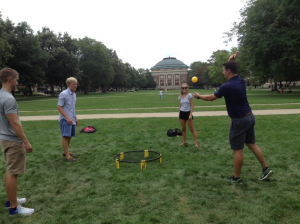 Students playing Spikeball on the main Quad.