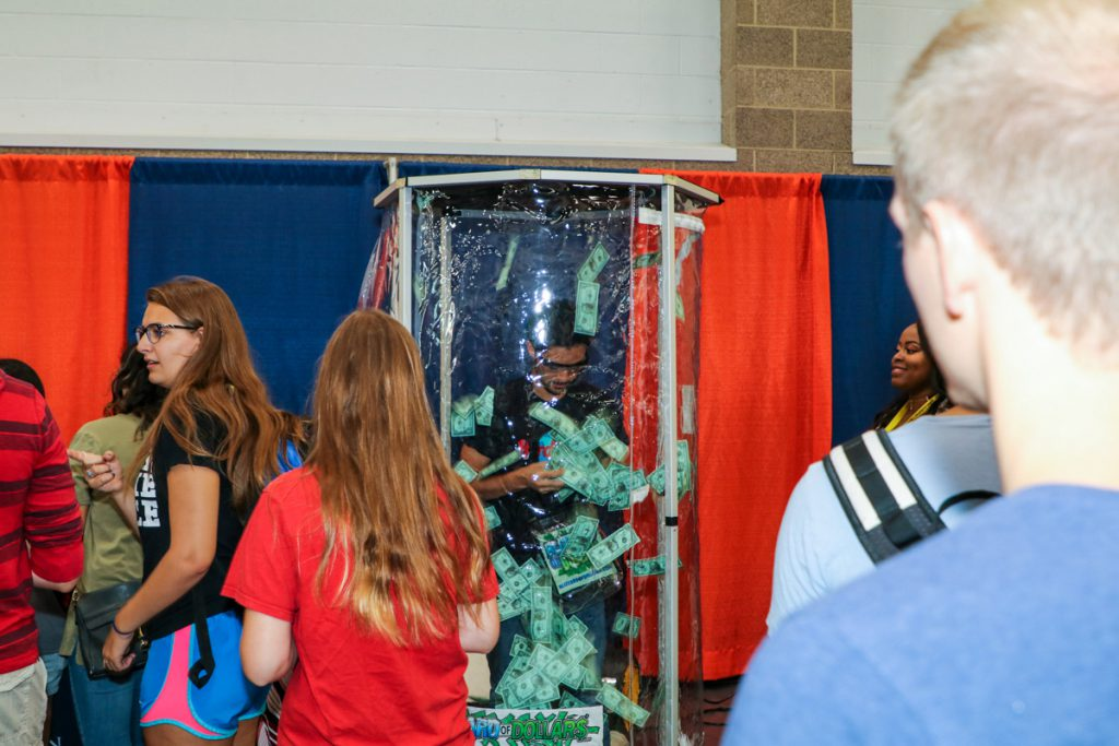 Student in a money blowing machine at the 2017 Illini Frenzy.