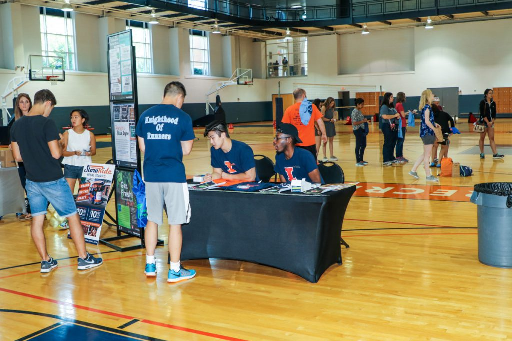 Campus Recreation employees talking to a student at the 2017 Illini Frenzy.