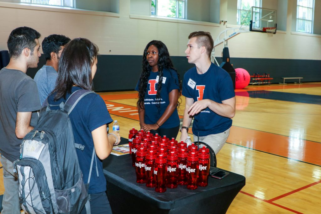 Campus Recreation employees talking to students at the 2017 Illini Frenzy.