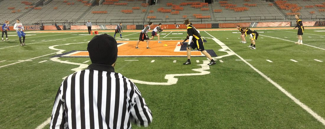 Two intramural flag football teams during a game.