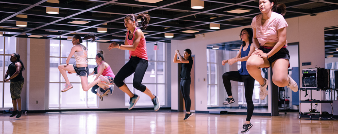 Students participating in a group fitness class