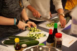 Students preparing food during a sushi cooking class in the ARC's Instructional Kitchen