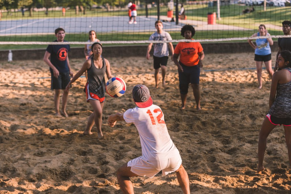 2 intramural sand volleyball teams battle it out Outdoor Center Fields