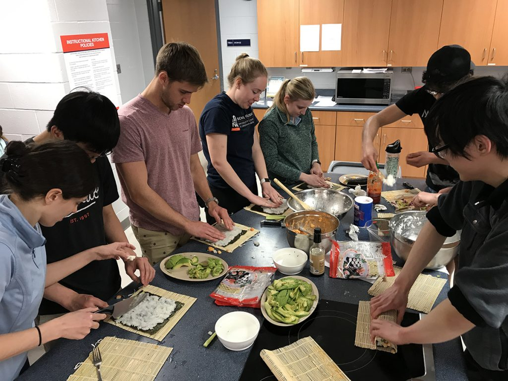 Photo of students partaking in the Sushi 1.0 Instructional Cooking Class.